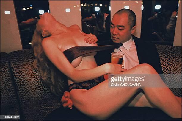 White girls strip for Japanese men in Seventh Heaven strip joint In Tokyo Japan On July 2002