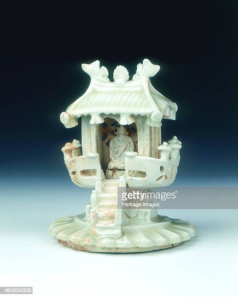 White glazed shrine Northern Song dynasty China 11th century A shrine with a figure possibly a Buddha sitting inside a pavilion surrounded by a...