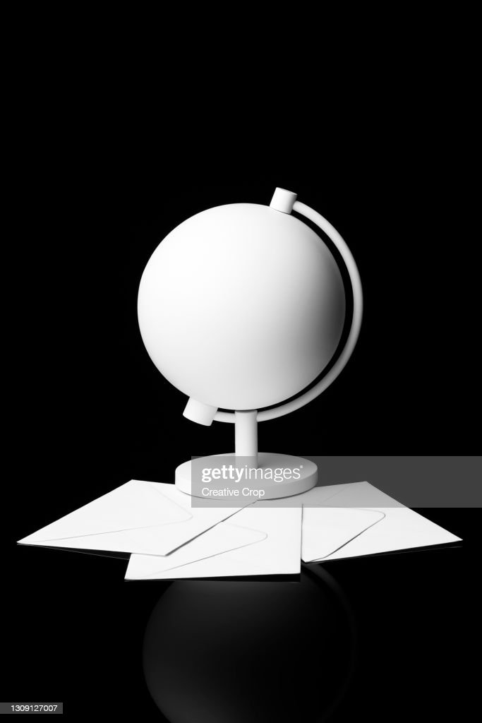 A white globe lays on a bed of black foam : Stock Photo