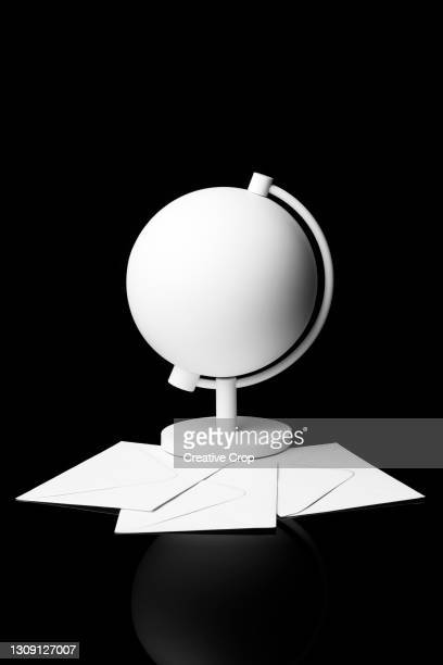 a white globe lays on a bed of black foam - microzoa stock pictures, royalty-free photos & images
