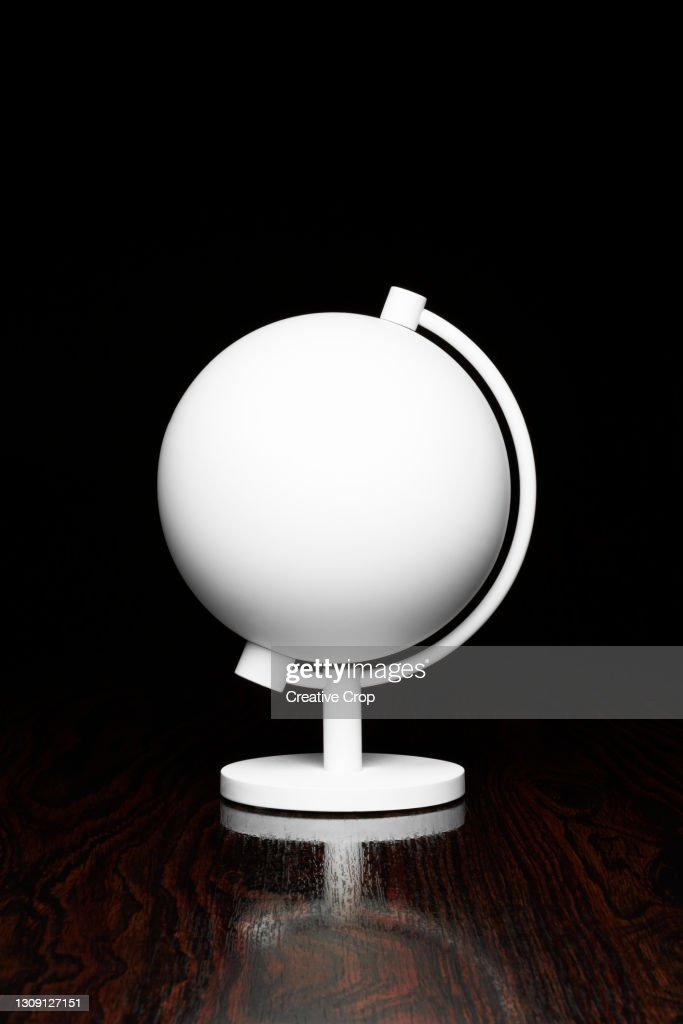 A white globe on a desktop : Stock Photo