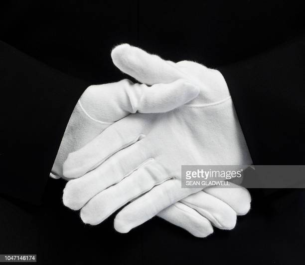 white gloves behind back - stereotypically upper class stock pictures, royalty-free photos & images