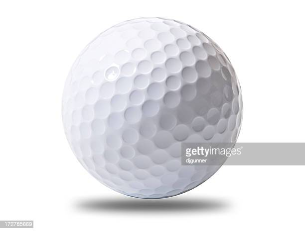 A white golf ball hovering above ground