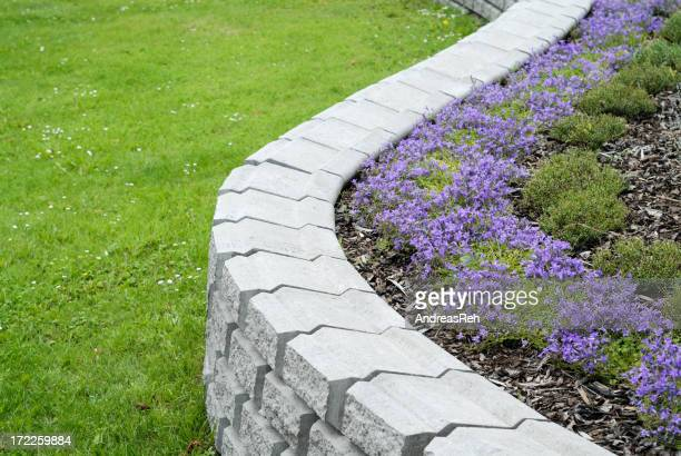 White granite garden ornament with flowers inside