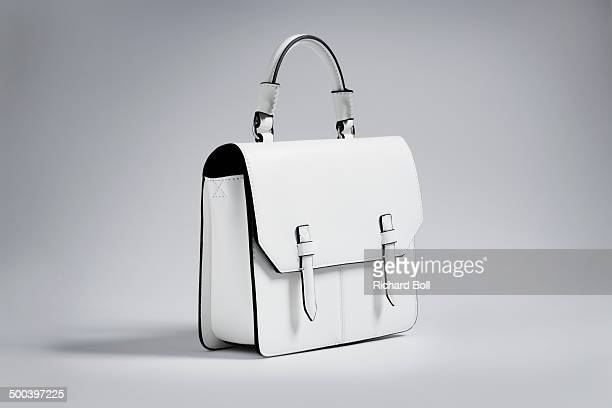 white handbag on a white background - clutch bag stock pictures, royalty-free photos & images