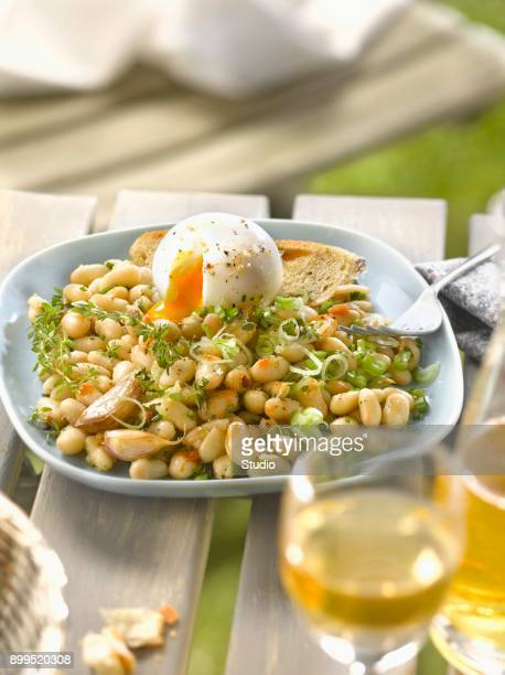 White haricot bean salad with pink garlic and a soft-boiled egg