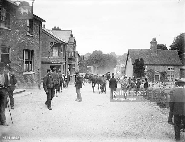 White Hart Inn East Ilsley Berkshire c1860c1922 Villagers and shepherds standing outside the inn during the village sheep market with two horses and...