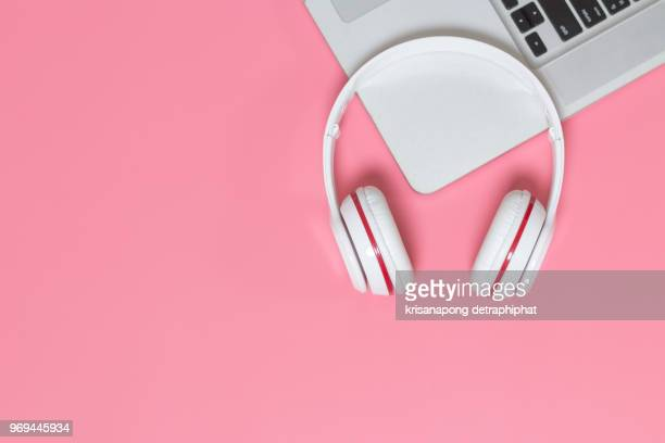 white  headphones on pink background - metal music stock photos and pictures
