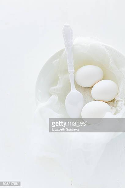 White heirloom eggs on cheese cloth