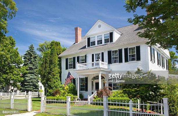 White Home with Picket Fence