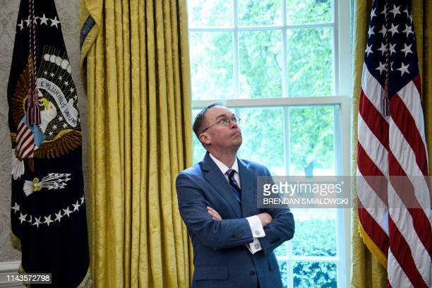 TOPSHOT White House acting Chief of Staff Mick Mulvaney listens while US President Donald Trump speaks to the press before a meeting with Hungary's...