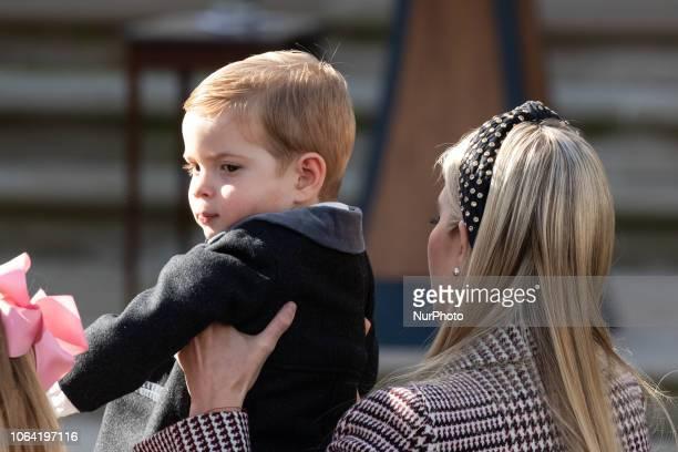 White House adviser and first daughter Ivanka Trump holding her son Theodore Kushner before US President Donald Trump pardons the National...