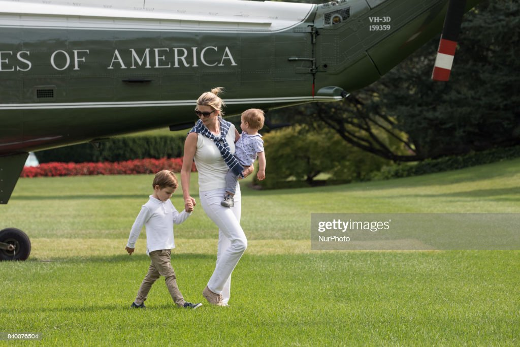 White House advisor Ivanka Trump with her sons, 3-year-old Joseph, and 1-year-old Theodore, walk across the South Lawn, after returning to the White House from a weekend at Camp David, on Sunday, August 27, 2017.