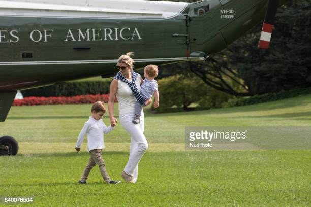 White House advisor Ivanka Trump with her sons 3yearold Joseph and 1yearold Theodore walk across the South Lawn after returning to the White House...