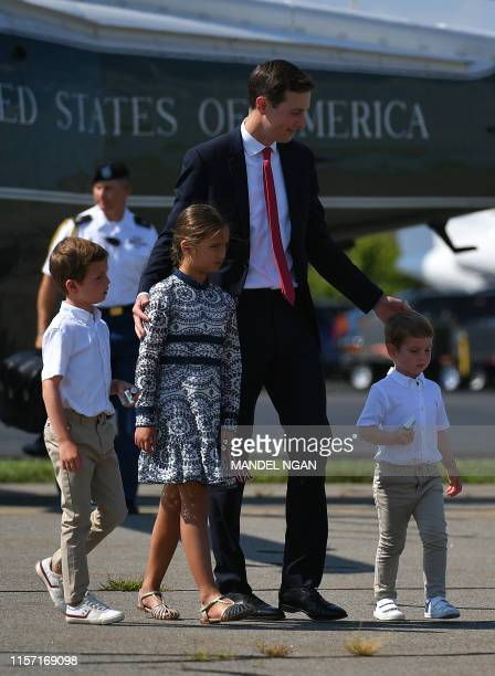 White House advisor Jared Kushner and his three children make their way to board Air Force One before departing from Morristown Municipal Airport in...