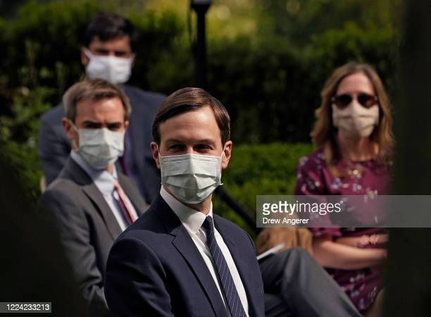 White House advisor Jared Kushner and others wear face masks while attending a press briefing about coronavirus testing in the Rose Garden of the...