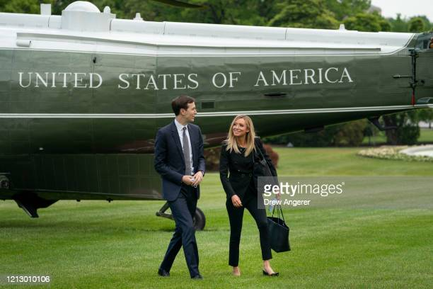 White House advisor Jared Kushner talks with White House Press Secretary Kayleigh McEnany as they exit Marine One and walk toward the White House on...