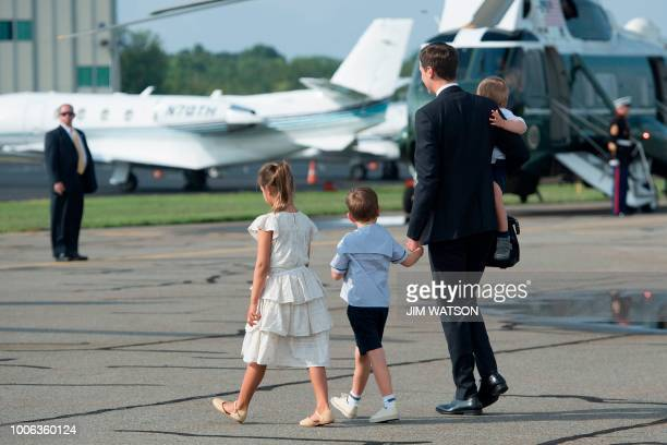 White House advisor Jared Kushner the soninlaw of US President Donald Trump walks of Airforce One at Morristown Municipal Airport with his children...
