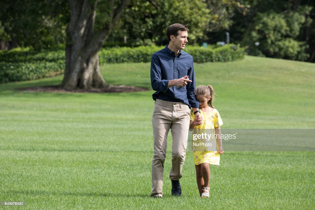 White House advisor Jared Kushner with his 6-year-old daughter Arabella, walk across the South Lawn, after returning to the White House from a weekend at Camp David, on Sunday, August 27, 2017.
