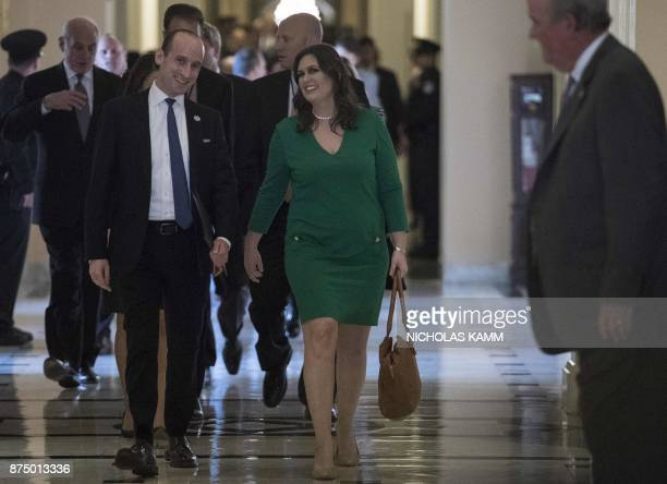 White House advisor Stephen Miller and Press Secretary Sarah Huckabee Sanders leave the US Capitol after US President Donald Trump met with the House...