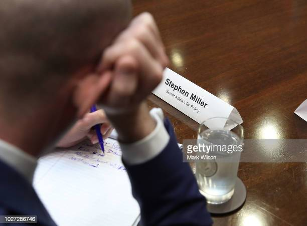 White House Advisor Stephen Miller writes on a note pad as US President Donald Trump speaks during a meeting with Congressional leaders in the...