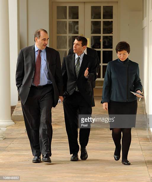 White House advisors David Axelrod David Plouffe and Valerie Jarrett walk through the Colonnade of the Rose Garden of the White House on January 25...