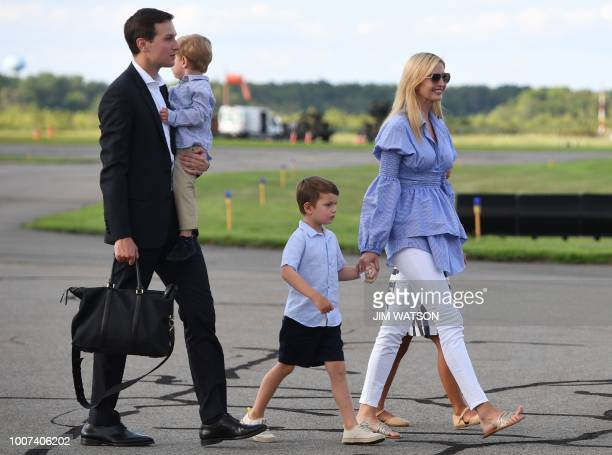 White House Advisors Jared Kushner and Ivanka Trump walk wth their children to board Air Force One at Morristown Municipal Airport on July 29 2018 in...