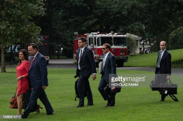 White House aides Press Secretary Sarah Huckabee Sanders Director of Social Media Dan Scavino Director of Presidential Personnel John DeStefano...