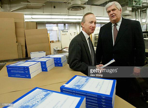 White House Budget Director Mitch Daniels and Public Printer of the United States Bruce R James pose with stacks of the newly printed 2004 US...