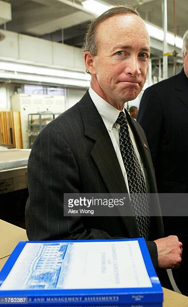 White House Budget Director Mitch Daniels answers questions from the media at the Government Printing Office January 29 2003 in Washington DC The...