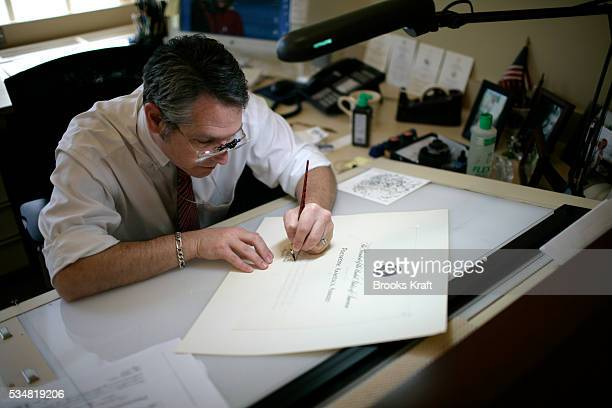 White House Calligraphers work on place cards and menus for the State Dinner in honor of the Queen Elizabeth II The White employees three full time...