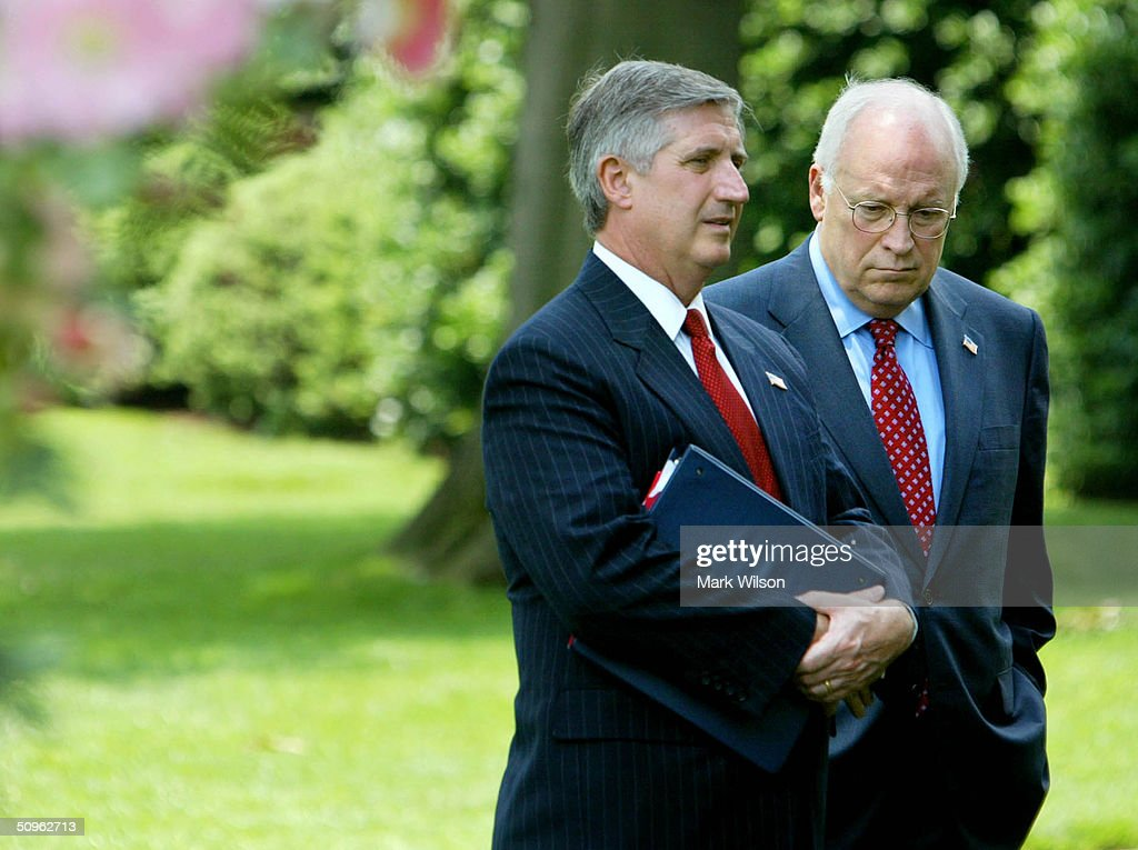 White House Cheif of Staff Andrew Card (L) and Vice President Dick Cheney stand near the Rose Garden while President George W. Bush and Afghan President Hamid Karzai are speak to reporters in the Rose Garden at the White House June 15, 2004 in Washington DC. The two leaders met to discuss the war on terrorism.