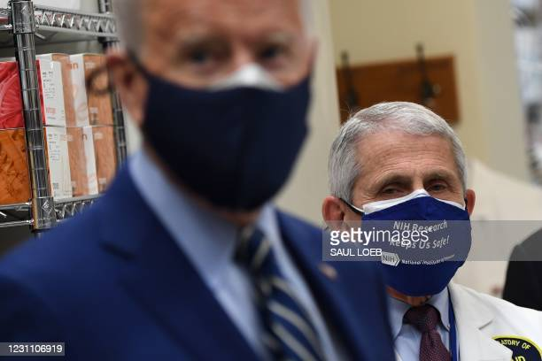 White House Chief Medical Adviser on Covid-19 Dr. Anthony Fauci looks on as US President Joe Biden tours the Viral Pathogenesis Laboratory at the...