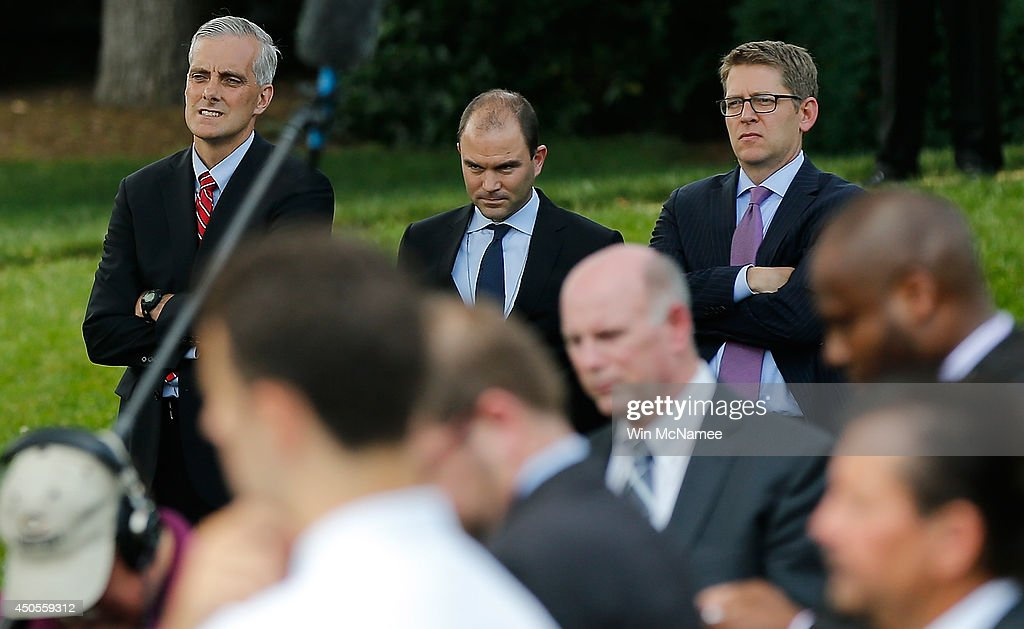 White House Chief of Staff Denis McDonough, Deputy National Security Advisor for strategic communication Ben Rhodes, and White House press secretary Jay Carney listen as U.S. President Barack Obama makes a statement on the situation in Iraq June 13, 2014 on the south lawn of the White House in Washington, DC. Obama said he will make a decision in the 'days ahead' about the use of American military power to aid the Iraqi government in its battle against Islamic insurgents.