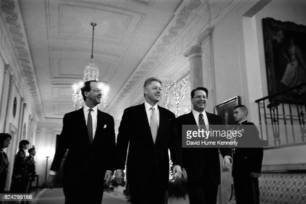 White House Chief of Staff Erskine Bowles President Bill Clinton and Vice President Al Gore walk through the White House Washington DC January 1998
