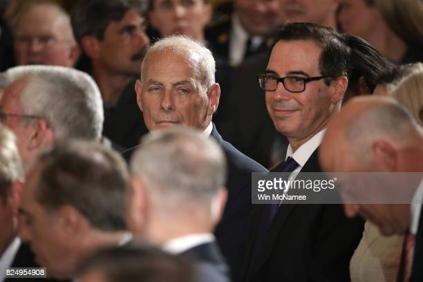 White House Chief of Staff Gen John Kelly and Treasury Secretary Steven Mnuchin attend a ceremony where US President Donald Trump presented the Medal...