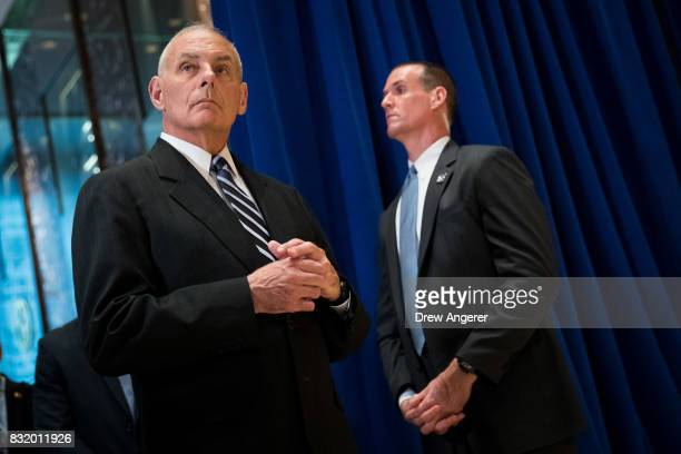White House Chief of Staff Gen John Kelly looks on as President Donald Trump speaks following a meeting on infrastructure at Trump Tower August 15...