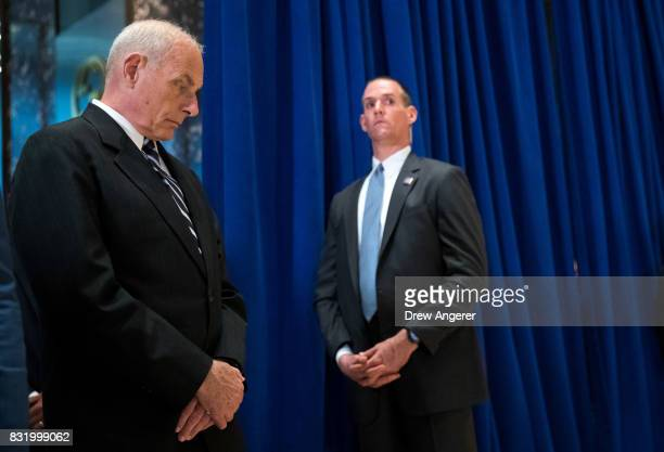 White House Chief of Staff Gen John Kelly looks on as US President Donald Trump speaks following a meeting on infrastructure at Trump Tower August 15...