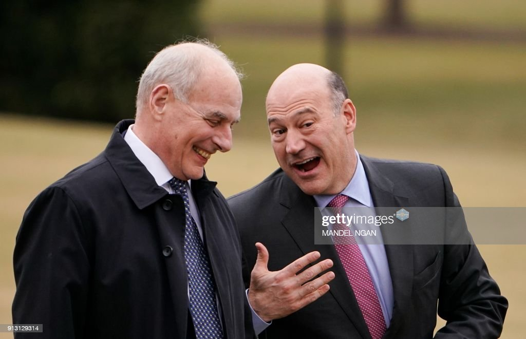 White House Chief of Staff John Kelly (L) and Director of the National Economic Council Gary Cohn walk across the South Lawn upon return to the White House on February 1, 2018 in Washington, DC. The two returned to Washington with US President Donald Trump after addressing the 2018 House and Senate Republican Member Conference. / AFP PHOTO / Mandel NGAN
