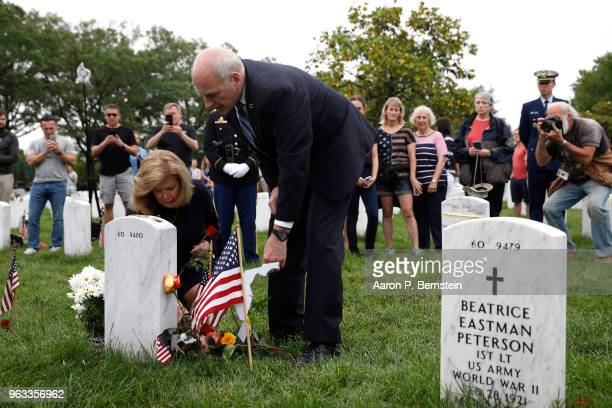 White House Chief of Staff John Kelly and his wife Karen pay their respects to their son Marine Lt Robert Kelly at Arlington National Cemetery on...