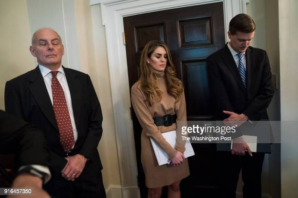 White House Chief of Staff John Kelly and White House Communications Director Hope Hicks listen as Housing and Urban Development Secretary Ben Carson...