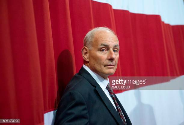 White House Chief of Staff John Kelly listens as US President Donald Trump speaks during a Make America Great Again Rally at Big Sandy Superstore...