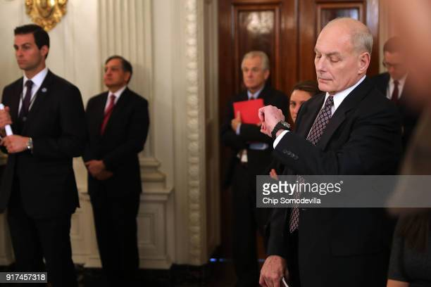 White House Chief of Staff John Kelly looks at his watch during an hourlong meeting where US President Donald Trump unveiled his administration's...