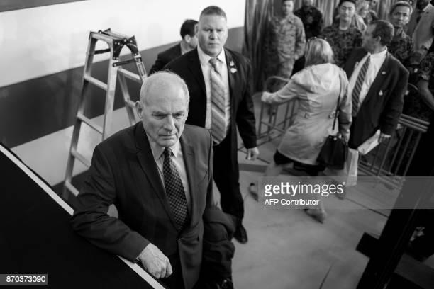White House Chief of Staff John Kelly looks on as US President Donald Trump greets troops during an event to speak with US military personnel at...