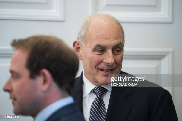 White House chief of staff John Kelly looks on as US President Donald Trump meets the Emir of Qatar Sheikh Tamim bin Hamad alThani at the White House...