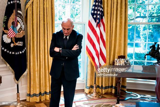 White House Chief of Staff John Kelly waits while Governor of Puerto Rico Ricardo Rossello and US President Donald Trump make statement to the press...