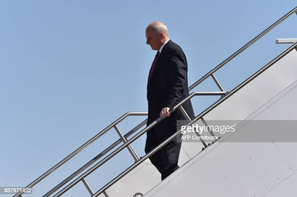 White House chief of staff John Kelly walks from Air Force One as he arrives with US President Donald Trump in Reno Nevada on August 23 where...