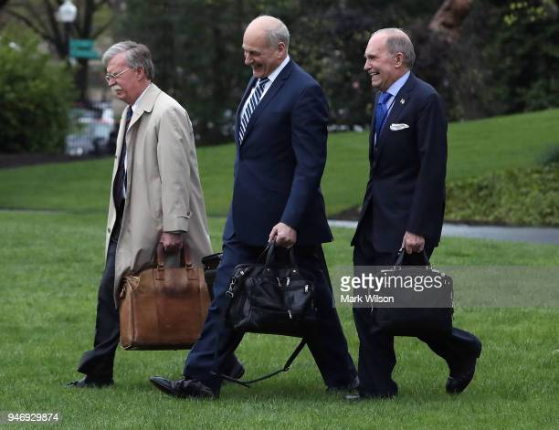 White House Chief of Staff John Kelly walks with National Security Advisor John Bolton and Economic Adviser Larry Kudlow toward Marine One before...