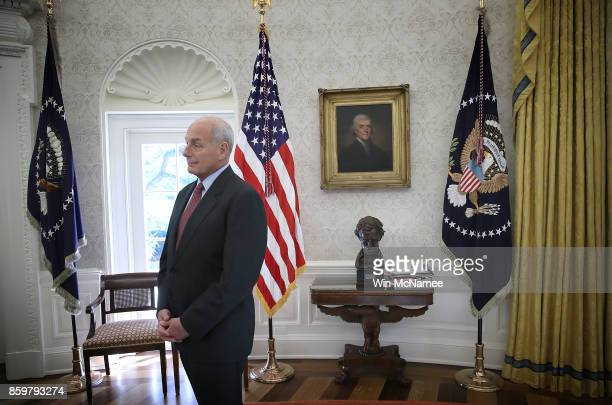White House Chief of Staff John Kelly watches as US President Donald Trump meets with former US Secretary of State Henry Kissinger in the Oval Office...