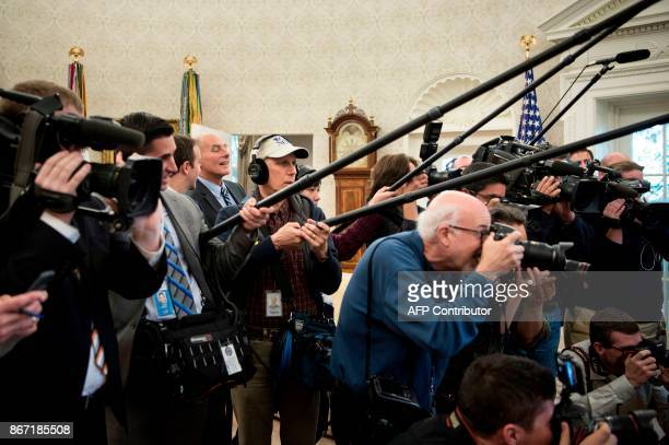 White House Chief of Staff John Kelly watches as US President Donald Trump meets with children of members of the press for Halloween in the Oval...